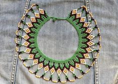 Unique handmade beaded necklace made by the Embéra-Chamí peoples of Colombia. It is a fun piece that will brighten up any outfit. It can be worn casually (e.g., underneath a jean jacket) or can be dressed up (e.g., black dress and strappy sandals)! I will be posting other necklaces I have purchased Beaded Necklace Patterns, Crochet Earrings, Hand Painted Furniture, Strappy Sandals, Chokers, Bead Necklaces, Beaded Jewellery, Jewels, Hobby