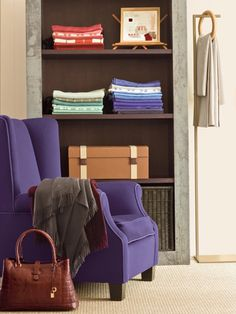 """Chair covered in """"Altai"""" with """"Altai"""" welt trim. Samples of Loro Piana fabrics stacked on shelf. Accent Chairs For Living Room, Formal Living Rooms, Purple Chair, Fabric Decor, Colorful Interiors, Interior Inspiration, Sweet Home, Interior Design, House Styles"""