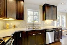 Photo about Modern luxury new dark brown and white kitchen with stainless steal appliances. Image of modern, refrigerator, real - 24268691 White Kitchen Appliances, White Kitchen Cabinets, Stainless Appliances, Brown Kitchen Designs, Dark Brown Cabinets, Brown Kitchens, White Countertops, Contemporary Kitchen Design, Kitchen Cabinet Colors