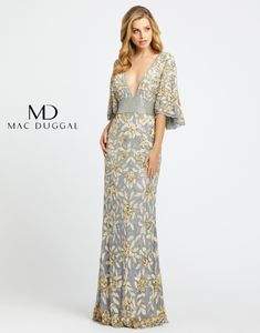 This Mac Duggal Couture platinum gold evening dress features a low V-neckline, jazzed up with scalloped cape sleeves and a beaded wide waistband. This fitted formal gown is crafted in floral sequin mesh, and finishes in a sweep train. Mother Of The Bride Dresses Long, Mother Of Bride Outfits, Long Mothers Dress, Mob Dresses, Types Of Dresses, Event Dresses, Lace Dresses, Floral Dresses, Gold Evening Dresses
