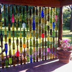 Bottle Wall is a DIY you'll love to try Add an amazing privacy screen to your garden or patio with this crafty and clever Glass Bottle Fence.Add an amazing privacy screen to your garden or patio with this crafty and clever Glass Bottle Fence. Wine Bottle Fence, Wine Bottle Crafts, Diy Bottle, Wine Craft, Glass Craft, Blue Bottle, Outdoor Projects, Diy Projects, Outdoor Decor