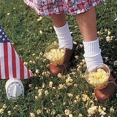 Popcorn relay race. Fun party game for outside in the summertime.