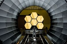 usagov: Image description: NASA engineer Ernie Wright looks on as the first six mirror segments from the James Webb Space Telescope are prepped to begin final cryogenic testing at NASA's Marshall Space Flight Center. Photo by David Higginbotham, NASA James Webb Space Telescope, Hubble Space Telescope, Nasa Space, Space Probe, Cosmos, Telescope Images, Nasa Engineer, Hubble Images, Internet Of Things