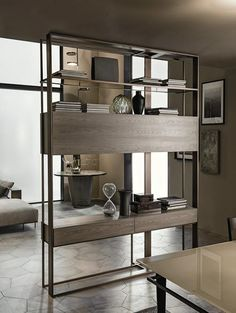 Shakedesign_Bookcases_Mod double sided bookcase with light bronze metal structure, ash wood elements in T49 cenere and bronze glass shelves