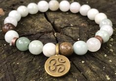 A personal favorite from my Etsy shop https://www.etsy.com/listing/521198924/jade-beaded-bracelet-with-om-charm-8mm