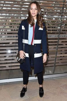 Another style win from Alicia Vikander who attended the Louis Vuitton PFW show in tailored trousers, a pretty blouse and nautical-style coat. She finished off the look with an LV over-the-shoulder bag and black brogues.