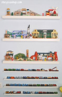 """Keep trains """"on track"""" atop picture ledges, and store larger accessories, like stations, bridges and water towers, on floating shelves. Get the tutorial at Stacy's Savings. More from Country Living: • Living Room Toy Storage • A DIY Solution to a Toy Car Overload • 8 Ways to Declutter Your Kid's Room  - GoodHousekeeping.com"""