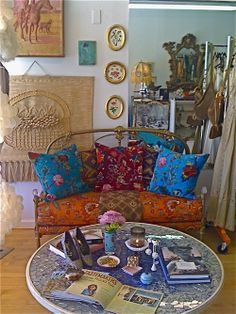 Vintage-headboard couch. Love the fabrics, the whole Bohemian look.