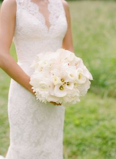 all white wedding bouquet with calla lilies + peonies + ranunculus