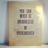 """Wall art in gold. Quote """"you can never be overdressed or overeducated"""" - oscar wilde"""