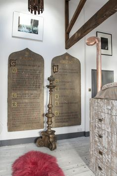 Recovered Church tableaux of the ten commandments have been given pride of place in the home