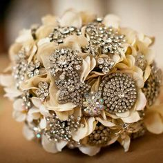 Antique Cream with Jewelled brooches.  Great Wedding Bouquet idea for the Bride to keep.