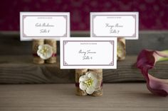 Place cards can be used creatively to match your wedding decor. love the idea of using wine corks for this!