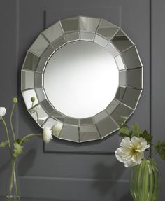 This round silver mirror has a lovely gorgeous frame which has little lines on it. The mirror is a unique mirror and is a very popular mirror of ours. This elegant mirror is a nice size and would look well in your home. Diameter: 80cm http://www.totalmirrors.com/1204-round-multifacet-rock-mirror-80cm--5055157622411.html
