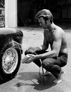Clint Eastwood washing his car, North Hollywood, California. 1958 – John R. Hamilton Collection