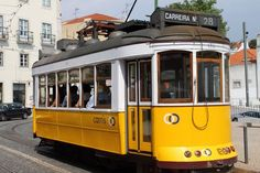 Electrico Tram 28 Lisbon / Electrico 28 (tram 28) is the vintage yellow tram that plies various routes in Lisbon. It goes through all over the city center, crossing many touristic attractions, while navigating along winding and very narrow streets to town up at sea level.