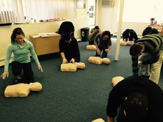 CPR students checking for responsiveness