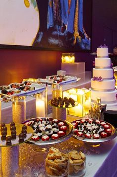 The cake is accompanied by an opulent dessert bar, featuring truffles, cupcakes and biscotti.