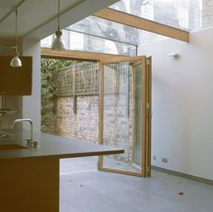 Lean-to glazed roof with sliding folding bi-door. Fantastic lighting as well