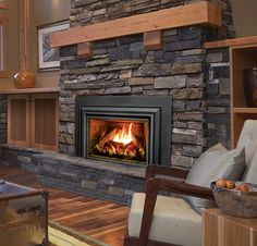 The Enviro E-Series - more options than ever! E33 Shown with Brick and Log firebox with extruded surround.   #fireplace #heat #fire #insert #hearth