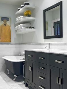 Modern cabinets + claw foot tub + gorgeous accessories + black/white = drama! That counter would also look great with the Pacific Connections black laquer vanity set. http://www.pioneerlinens.com/pacific-connections-black-lacquer-vanity-set