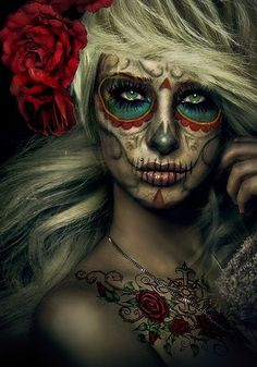 Dia de Los Muertos makeup ....painted my face like this for a practce run for Halloween!!  Now going to pair it with an ugly wedding dress  veil. lol