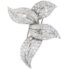 BOUCHERON . Stunning platinum and diamond four leaf brooch pin by Boucheron, circa 1950s. It features a 4 leaf design, with the leaves being intertwined together. Diamonds are old European cut, single cut baguette cut representing the veins of the leaves, with approx. 10-12cts total weight. Brooch signed Monture Boucheron. Hallmarks: French marks for gold and platinum, Monture Boucheron. France circa 1950s