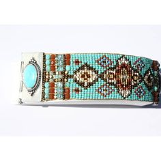 This beauty is the essence of all things Southwestern. Taking the woven bead tradition to a new modern aesthetic, Adonnah Langer creates an heirloom quality bracelet, a must for any collector!. Each end frames the woven rug pattern formed from brass, Czech and Japanese fire polished faceted beads! Adonnah's sterling silver and turquoise  stones are bezel set beautifully to make a dramatic statement! Can be worn two different ways~ with the hand beaded band showing or with the clasp with the…
