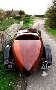 1930 Talbot (all wood; crafted by luxury yacht & boat maker); Honduran mahogany with black leather interiors and other art decor