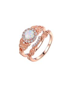 Make an eye-catching statement with this set of elegant rings.Includes two ringsFace: 0.8'' H x 0.4'' L18k rose gold-plated brass / opal / cubic zirconiaImported