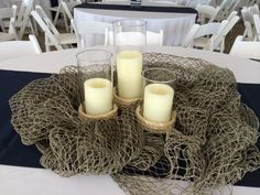 Nautical candle centerpiece with fishing net fish centerpiece, nautical cen Fish Centerpiece, Nautical Centerpiece, Nautical Theme Decor, Candle Centerpieces, Wedding Centerpieces, Fishing Wedding, Beach Wedding Favors, Nautical Wedding, Fishing Engagement