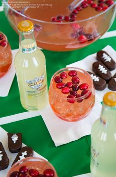 Get Game Day Ready this Thanksgiving with the four F's.  Football, #Food, #Family, and most importantly-- fruity drinks. tailgate cocktail  Recipe: 3 bottles Smirnoff ICE Moscow Mule, 3 Cups Cranberry Juice, Garnish with Cranberry