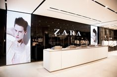 The cashwrap is at the back of the store and features floor-to-ceiling lightboxes with moving images designed to capture shoppers' attention. Photography courtesy of Zara, London.View Image Details