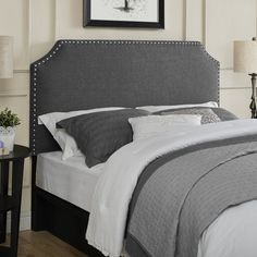 An arched headboard pairs with silver nailhead trim to give this upholstered bed elegant style. Use it to add a refined touch to your bed room or guest room, then pair it with crisp white linens for a resort-worthy look.