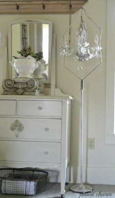 Small Chandelier hung in a vintage birdcage stand - never thought of that!! <3  - (from Faded Charm blog)