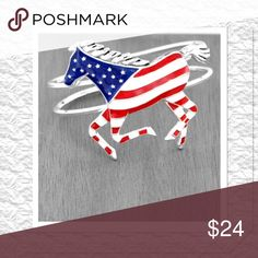 """Silvertone Horse Hinged Bracelet This US Flag horse bracelet is the perfect accessory for any day you're feeling patriotic. Silvertone alloy with Enameled flag design, horse 2"""" x 2.75"""", 5"""" wide band, hinge closure, fits S/M wrist Boutique Jewelry Bracelets"""