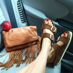 Fringe clutch and Birkenstocks with a sneaker sole (aka the most comfortable shoes ever. My heel reimmersion challenge begins Monday so I need to enjoy them while I can ). Link to learn more about the Birks in my bio...