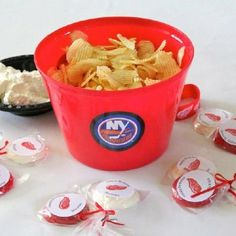 Used hockey decor from party city, dollar store buckets, printed stickers for suckers