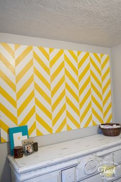 Stencil a large board instead of a full wall. Makes a statement piece that is not permanent.