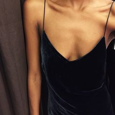 Simple black velvet slip dress.