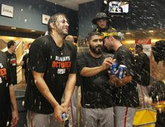 PITTSBURGH, PA - OCTOBER 01: Michael Morse #38 of the San Francisco Giants celebrates in the locker room after they defeated the Pittsburgh Pirates 8 to 0 during the National League Wild Card game at PNC Park on October 1, 2014 in Pittsburgh, Pennsylvania. (Photo by Justin K. Aller/Getty Images)
