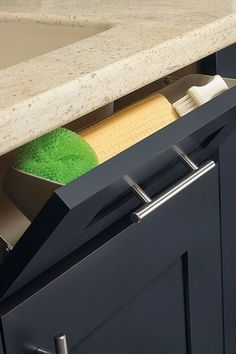 Hide away damp kitchen sponges and scrubbers right below the sink with Kitchen Craft's Tilt-Out Tray.