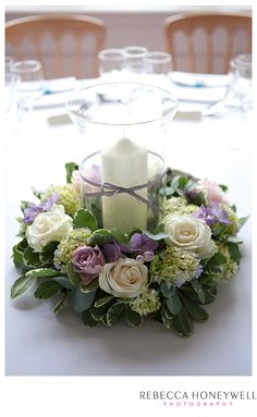 Floral ring with hurricane vase and candle.  Roses, Hydrangea and Freesia.