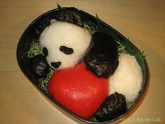 OMG i LOVE THIS!!!! how could you eat it though? id end up covered in sticky rice from trying to give the panda a cudle :/