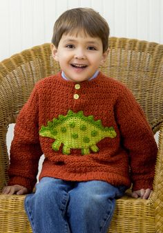 I think I'll make this in a size 4 so by time I finish it, he'll still be able to ware it.  Maybe in blue with green dinosaur.