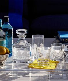 Ralph Lauren's equestrian-inspired Garrett barware is crafted from hand-cut crystal and features a sandblasted design of a spirited polo match