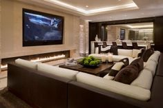 Elegant home Theater Interior Decoration with Large TV Screen Trendy Fireplace and U Shaped Sectional Sofa