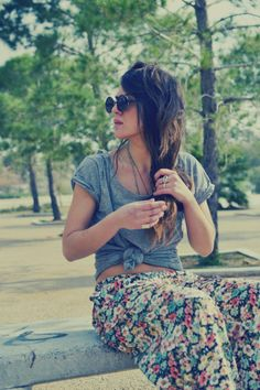 Simple, but boho-chic. Small dark floral print flowing pants with a gray Tee tied at the waist to show your curves.