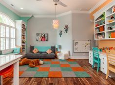 Like the grey, orange and teal combo in this room. Maybe a good combo for the kids room in the basement?