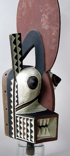Kobiay mask, Bwa people, Burkina Fasso 25 inches, painted wood Like the popular hawk mask, this strange looking creature is also considered to be a protective spirit.